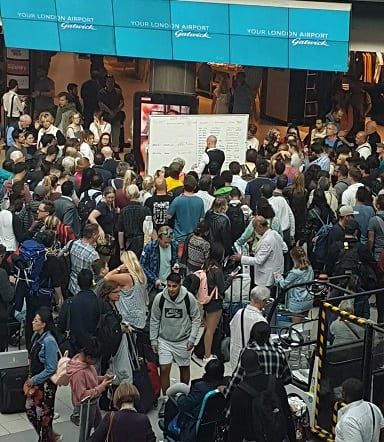Chaos at London Gatwick Airport as display boards go blank