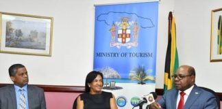 Tourism Minister, Hon. Edmund Bartlett articulates a point to members of the media and his senior members of staff during