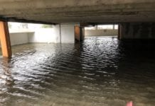 AccuWeather National Weather Reporter Jonathan Petramala captures the lower level of a parking structure in Myrtle Beach, S.C.