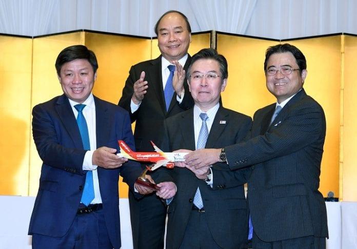 Vietnam Prime Minister Nguyen Xuan Phuc (2nd row) witnesses Vietjet's new route announcement ceremony