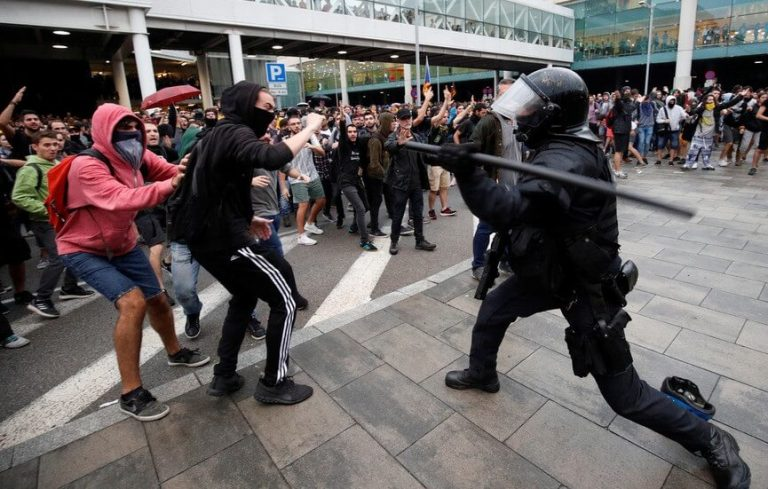 Flights canceled as Barcelona Airport becomes battlefield between protesters and police