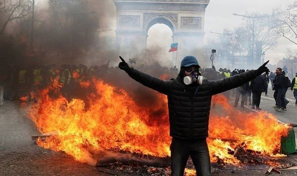 Chaos in Paris: Riots, burning cars and clouds of tear gas