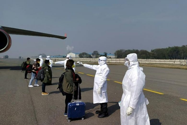 India bans all commercial flight arrivals to contain coronavirus spread