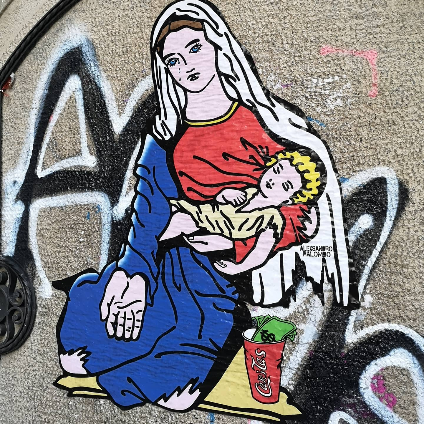 """Caritas"": Street art that highlights the tragedy of our days"