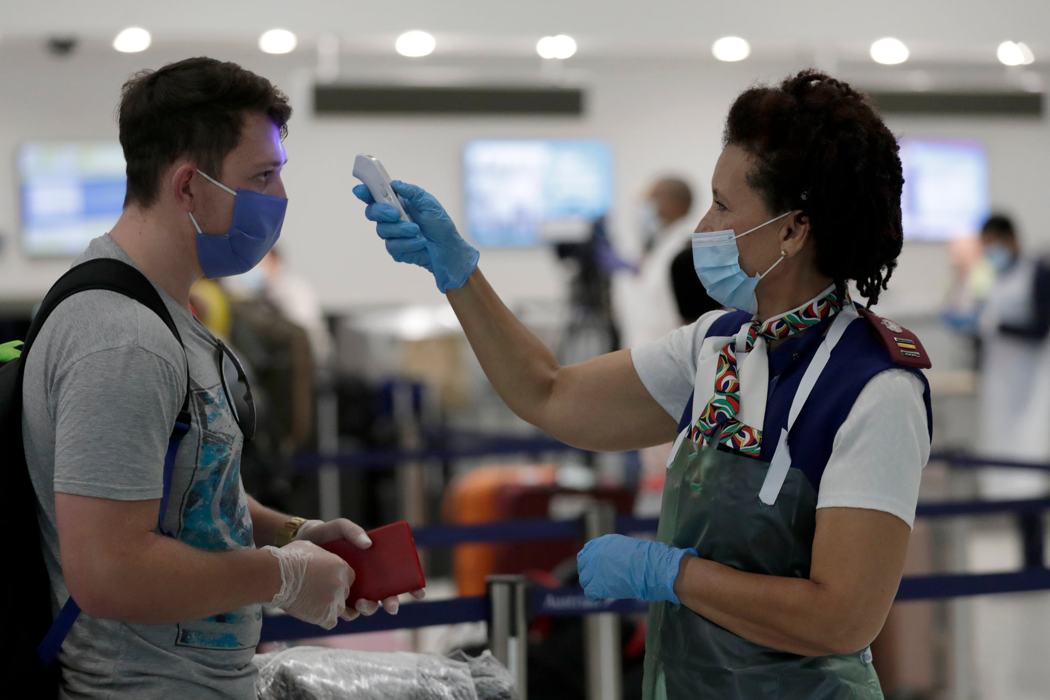 US airlines pledge refunds for passengers denied boarding by airport temperature checks